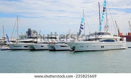KAOHSIUNG, TAIWAN -- MAY 11, 2014: Luxurious yachts and pleasure boats are on display during the 2014 Taiwan International Boat Show. - stock photo