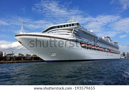 KAOHSIUNG, TAIWAN -- MAY 11, 2014:  The gem class cruise ship Diamond Princess with more than 2000 passengers on board docks at Kaohsiung Harbor. - stock photo