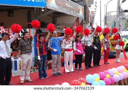 KAOHSIUNG, TAIWAN -- NOVEMBER 20, 2015: Local politicians and businessmen perform the ribbon cutting ceremony at the opening of the Jiangguo Outdoor Market.