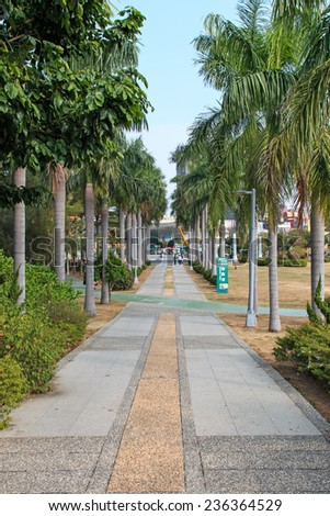 Kaohsiung, Taiwan - November 08, 2014: People walking in Central Park
