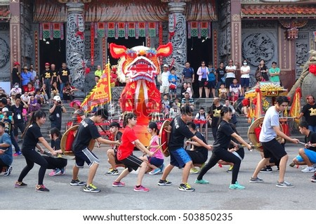 KAOHSIUNG, TAIWAN -- OCTOBER 15, 2016: Young people put on a martial art performance in front of the Yuan Di Temple during the yearly Wannian Folk Festival.