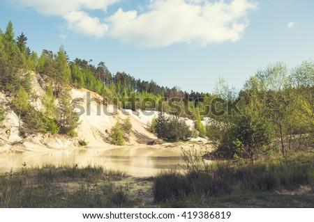 Kaolin quarry in Czech Republic, vintage filters - stock photo