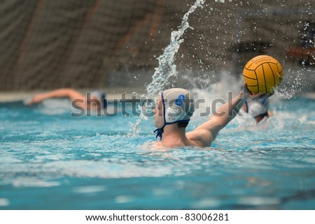 KAPOSVAR, HUNGARY - APRIL 2: Norbert Juhasz (white 8) in action at a Hungarian national championship water-polo game between Kaposvari VK (white) and AVSE (blue) on April 2, 2011 in Kaposvar, Hungary