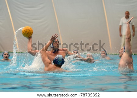 KAPOSVAR, HUNGARY - APRIL 16: Unidentified players in action at a Hungarian national championship water-polo game between Kaposvari VK and Hegyvidek Ybl WPC on April 16, 2011 in Kaposvar, Hungary