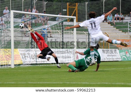 KAPOSVAR, HUNGARY - AUGUST 14: Daniel Rozsa (L) in action at a Hungarian National Championship soccer game Kaposvar vs. Haladas August 14, 2010 in Kaposvar, Hungary. - stock photo