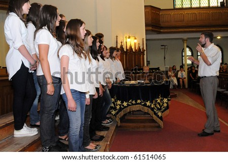 KAPOSVAR, HUNGARY - AUGUST 26: Members of the Franz Schubert Children's Choir (SVK) sing at the IV. Pannonia Cantat Youth Choir Festival August 26, 2010 in Kaposvar, Hungary