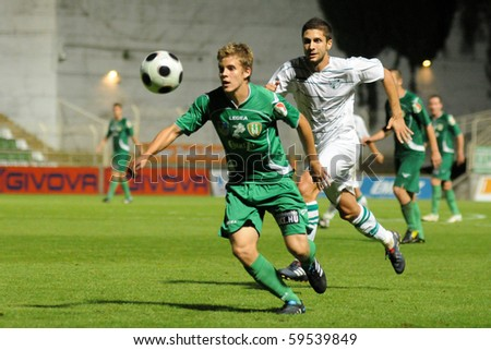 KAPOSVAR, HUNGARY - AUGUST 14: Players in action at a Hungarian National Championship soccer game Kaposvar vs. Haladas August 14, 2010 in Kaposvar, Hungary. - stock photo