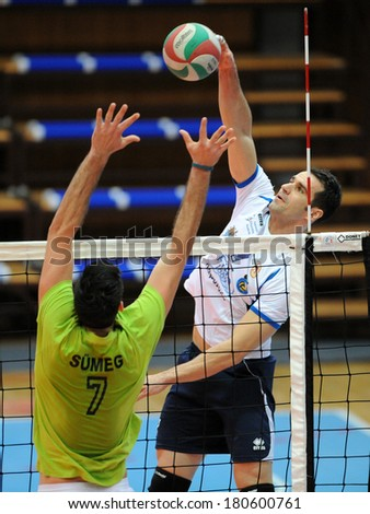 KAPOSVAR, HUNGARY - FEBRUARY 25: Andras Geiger (white 7) in action at a Hungarian National Championship volleyball game Kaposvar (white) vs. Sumeg (green), February 25, 2014 in Kaposvar, Hungary. - stock photo