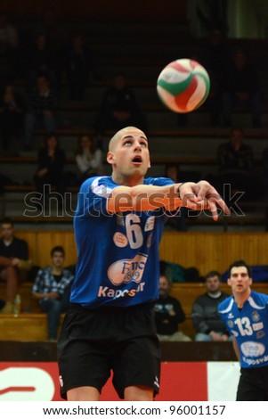 KAPOSVAR, HUNGARY - FEBRUARY 23: Balint Magyar in action at a Hungarian volleyball National Championship game Kaposvar (blue) vs. Csepel ( deep blue), on February 23, 2012 in Kaposvar, Hungary. - stock photo