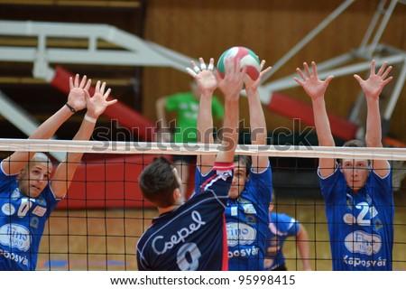 KAPOSVAR, HUNGARY - FEBRUARY 23: Bence Bozoki (2) in action at a Hungarian volleyball National Championship game Kaposvar (blue) vs. Csepel ( deep blue), on February 23, 2012 in Kaposvar, Hungary. - stock photo