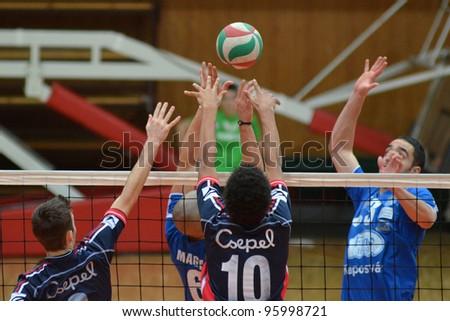 KAPOSVAR, HUNGARY - FEBRUARY 23: Jozsef Nagy (R) in action at a Hungarian volleyball National Championship game Kaposvar (blue) vs. Csepel ( deep blue), on February 23, 2012 in Kaposvar, Hungary. - stock photo