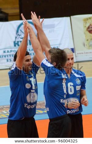 KAPOSVAR, HUNGARY - FEBRUARY 23: Kaposvar players celebrate before a Hungarian volleyball National Championship game Kaposvar (blue) vs. Csepel (deep blue), on February 23, 2012 in Kaposvar, Hungary. - stock photo