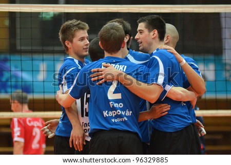 KAPOSVAR, HUNGARY - FEBRUARY 23: Kaposvar players compete at a Hungarian volleyball National Championship game Kaposvar (blue) vs. Csepel ( deep blue), on February 23, 2012 in Kaposvar, Hungary. - stock photo