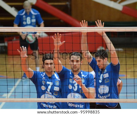 KAPOSVAR, HUNGARY - FEBRUARY 23: Kaposvar players in action at a Hungarian volleyball National Championship game Kaposvar (blue) vs. Csepel ( deep blue), on February 23, 2012 in Kaposvar, Hungary. - stock photo