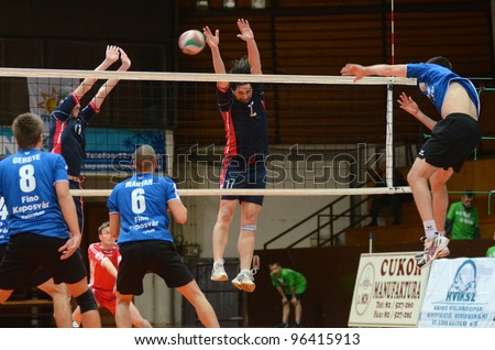KAPOSVAR, HUNGARY - FEBRUARY 27: Karoly Lesznyik (R) in action at a Hungarian volleyball National Championship game Kaposvar (blue) vs. Csepel ( deep blue), on February 27, 2012 in Kaposvar, Hungary.