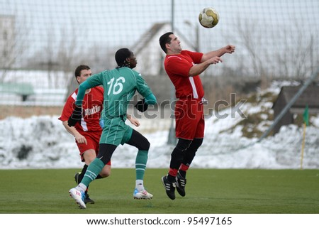 KAPOSVAR, HUNGARY - FEBRUARY 18: Mustapha Diallo (green 16) in action at a friendly soccer game Kaposvar (green) vs. Dombovar (red) - February 18, 2012 in Kaposvar, Hungary. - stock photo