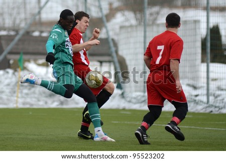 KAPOSVAR, HUNGARY - FEBRUARY 18: Mustapha Diallo (in green) in action at a friendly soccer game Kaposvar (green) vs. Dombovar (red) - February 18, 2012 in Kaposvar, Hungary.