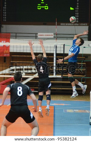 KAPOSVAR, HUNGARY - FEBRUARY 12: Roland Gergye (R) in action at a Hungarian volleyball National Championship game Kaposvar (blue) vs. Debrecen (black), on February 12, 2012 in Kaposvar, Hungary.