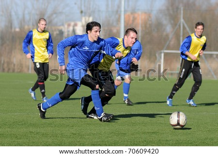 KAPOSVAR, HUNGARY - FEBRUARY 5: Unidentified players in action at a friendly soccer game Nagybajom vs. Balatonlelle (CRO) - February 5, 2011 in Kaposvar, Hungary. - stock photo