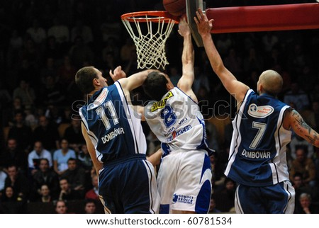 KAPOSVAR, HUNGARY - FEBRUARY 17: Unidentified players in action at a Hugarian Championship basketball game Kaposvar vs. Dombovar February 17, 2007 in Kaposvar, Hungary.