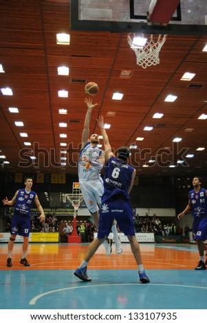 KAPOSVAR, HUNGARY - FEBRUARY 23: Unidentified players in action at Hungarian Championship basketball game with Kaposvar (w) vs. Sopron (b) on February 23, 2013 in Kaposvar, Hungary. - stock photo