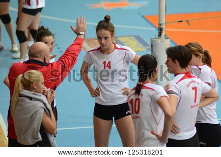 KAPOSVAR, HUNGARY - JANUARY 13: BSE players listening to their trainer at the Hungarian I. League volleyball game Kaposvar (white) vs Budapest SE (white), January 13, 2013 in Kaposvar, Hungary. - stock photo