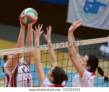 KAPOSVAR, HUNGARY - JANUARY 13: Ingrid Duduka (L) in action at the Hungarian I. League volleyball game Kaposvar (white) vs Budapest SE (white), January 13, 2013 in Kaposvar, Hungary. - stock photo