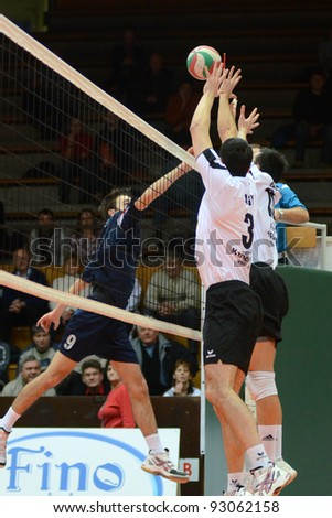 KAPOSVAR, HUNGARY - JANUARY 15: Jozsef Nagy(3) in action at a Hungarian volleyball National Championship game Kaposvar (white) vs. Csepel (blue), on January 15, 2012 in Kaposvar, Hungary.