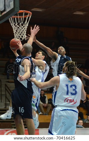 KAPOSVAR, HUNGARY - JANUARY 26: Tamas Markus (2nd from L) in action at a Hugarian Cup basketball game Kaposvar vs. Szeged January 26, 2011 in Kaposvar, Hungary.