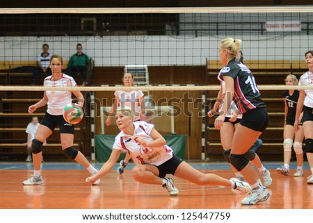 KAPOSVAR, HUNGARY - JANUARY 13: Zsofia Horvath (5) in action at the Hungarian I. League volleyball game Kaposvar (white) vs Budapest SE (white), January 13, 2013 in Kaposvar, Hungary.