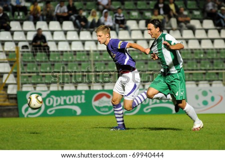 KAPOSVAR, HUNGARY - JULY 24: Lorant Olah (R) in action at a Hungarian Liga Cup soccer game Kaposvar vs. Ujpest July 24, 2010 in Kaposvar, Hungary.