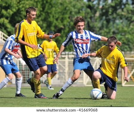 KAPOSVAR, HUNGARY - JULY 21: Unidentified players in action at the V. Youth Football Festival match Upper Beeding FC (ENG) vs Svolvaer IL (NOR) on July 21, 2009 in Kaposvar, Hungary.