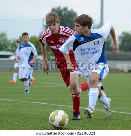 KAPOSVAR, HUNGARY - JULY 23: Unidentified players in action at the VII. Youth Football Festival Under 16 Final Luneburg (red)(GER) vs. Brescia Academy (white) (ITA) July 23, 2011 in Kaposvar, Hungary - stock photo