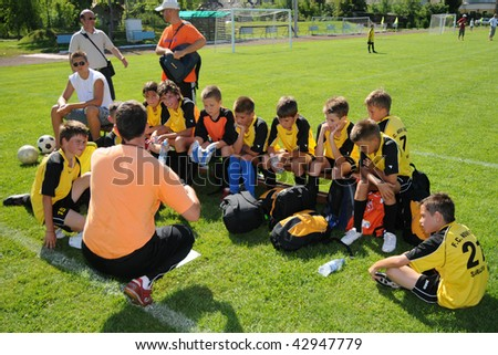 KAPOSVAR, HUNGARY - JULY 20: Unidentified players listen to their trainer at the V. Youth Football Festival match - July 20, 2009 in Kaposvar, Hungary. - stock photo