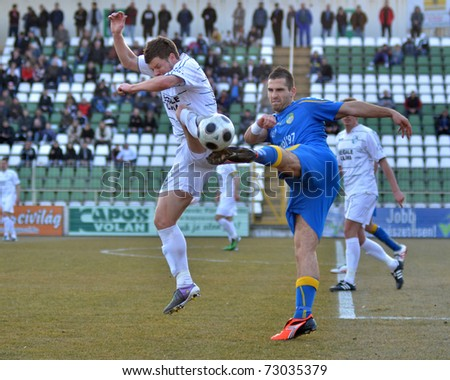 KAPOSVAR, HUNGARY - MARCH 12: Bojan Pavlovic (L) in action at a Hungarian National Championship soccer game Kaposvar vs Siofok March 12, 2011 in Kaposvar, Hungary.
