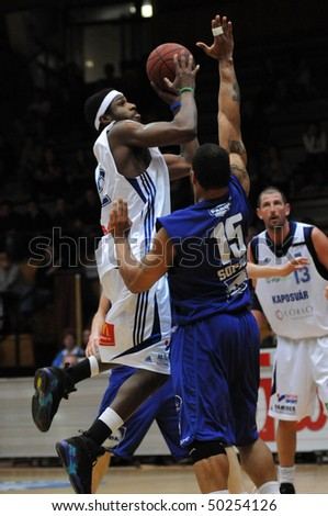KAPOSVAR, HUNGARY - MARCH 31: Larry Welton (L) in action at a Hugarian Cup basketball game Kaposvar vs. Sopron March 31, 2010 in Kaposvar, Hungary. - stock photo