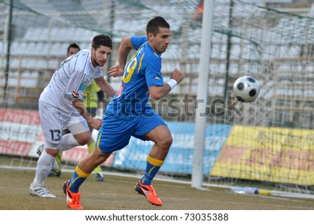 KAPOSVAR, HUNGARY - MARCH 12: Okuka Drazen (in white) in action at a Hungarian National Championship soccer game Kaposvar vs Siofok March 12, 2011 in Kaposvar, Hungary.
