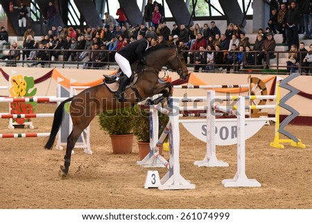 KAPOSVAR, HUNGARY - MARCH 15: Zsolt Kiss jumps with his horse (Carnero) on the Masters Tournament International Jumping Competition, March 15, 2015 in Kaposvar, Hungary - stock photo