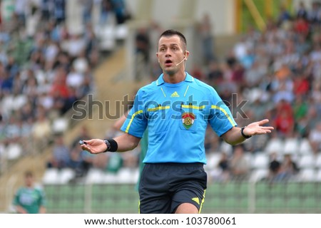 KAPOSVAR, HUNGARY - MAY 12: Balazs Berke (referee) in action at a Hungarian National Championship soccer game Kaposvar (green) vs Szombathely (black) May 12, 2012 in Kaposvar, Hungary.