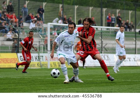 KAPOSVAR, HUNGARY - MAY 5: Lorant Olah (in white) in action at a Hungarian National Championship soccer game Kaposvar vs Budapest Honved May 5, 2008 in Kaposvar, Hungary.