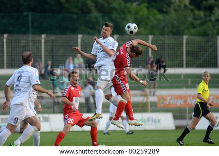 KAPOSVAR, HUNGARY - MAY 14: Unidentified players in action at a Hungarian National Championship soccer game - Kaposvar vs Szolnok on May 14, 2011 in Kaposvar, Hungary. - stock photo