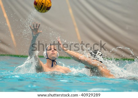 KAPOSVAR, HUNGARY - NOVEMBER 14: Juhasz-Szelei (L) in action at a Hungarian National Championship water-polo game (Kaposvar vs Kecskemet), November 14, 2009 in Kaposvar, Hungary