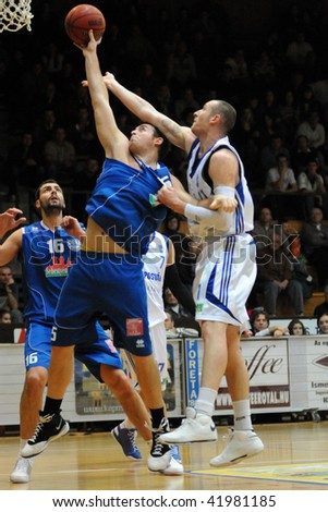 KAPOSVAR, HUNGARY - NOVEMBER 28: Roland Hendlein (in white) in action at Hungarian National Championship basketball game with Kaposvar vs Debrecen on November 28, 2009 in Kaposvar, Hungary.