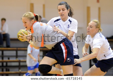 KAPOSVAR, HUNGARY - NOVEMBER 21: Szabina Reichert (C) in action at Hungarian Handball National Championship III. match (Kaposvar vs. Mesztegnyo) November 21, 2010 in Kaposvar, Hungary.