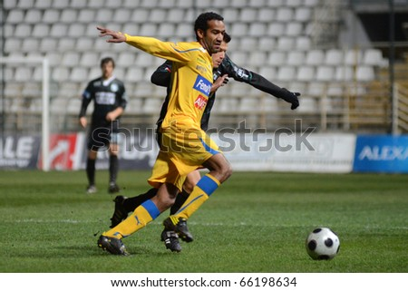 KAPOSVAR, HUNGARY - NOVEMBER 24: Thiago (in yellow) in action at a Hungarian Liga Cup soccer game Kaposvar vs BFC Siofok November 24, 2010 in Kaposvar, Hungary. - stock photo