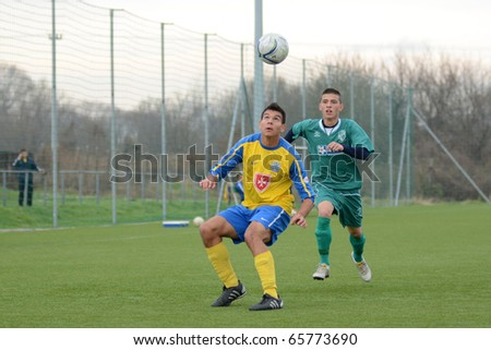 KAPOSVAR, HUNGARY - NOVEMBER 20: Unidentified players in action at the Hungarian National Championship under 19 game between Kaposvar and Puskas Academy November 20, 2010 in Kaposvar, Hungary.