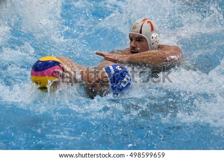 KAPOSVAR, HUNGARY - OCTOBER 5: Gergely Pataki (white 7) in action at a Hungarian national championship waterpolo game between Kaposvar (white) and Honved (blue) on October 5, 2016 in Kaposvar, Hungary