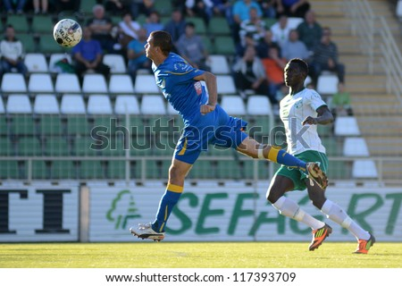 KAPOSVAR, HUNGARY - OCTOBER 20: Jammeh Haruna (in white) in action at a Hungarian National Championship soccer game - Kaposvar (white) vs Siofok (blue) on October 20, 2012 in Kaposvar, Hungary.