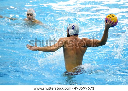 KAPOSVAR, HUNGARY - OCTOBER 5: Jozsef Berta (white 5) in action at a Hungarian national championship water-polo game between Kaposvar (white) and Honved (blue) on October 5, 2016 in Kaposvar, Hungary