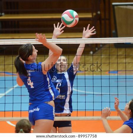 KAPOSVAR, HUNGARY - OCTOBER 23: Kamilla Gyorbiro (R) in action at a Hungarian NB I. League woman volleyball game Kaposvar vs Bekescsaba, October 23, 2011 in Kaposvar, Hungary. - stock photo